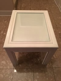 White wicker end table with glass top