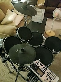 Alesis DM 10 Drum set with brand new DW throne