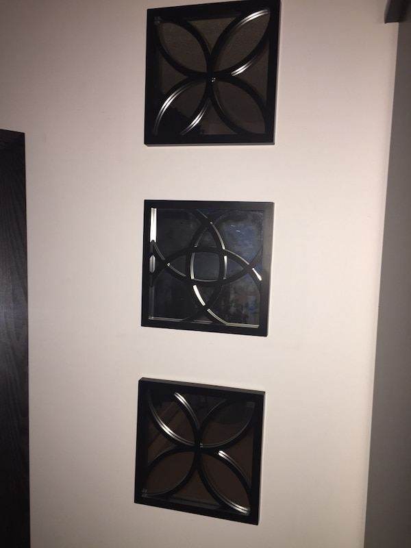 Three square black framed mirror wall decors
