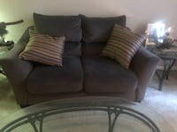 Couch and love seat grayish in color could even pass for tan Delray Beach, 33484