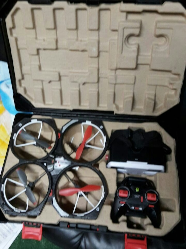 black, white, and red drone quadcopter with case