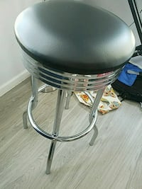 round stainless steel base black leather padded se
