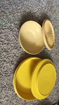 Two beige and yellow Tupperware containers with lids