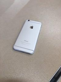 silver iPhone 6 with white case