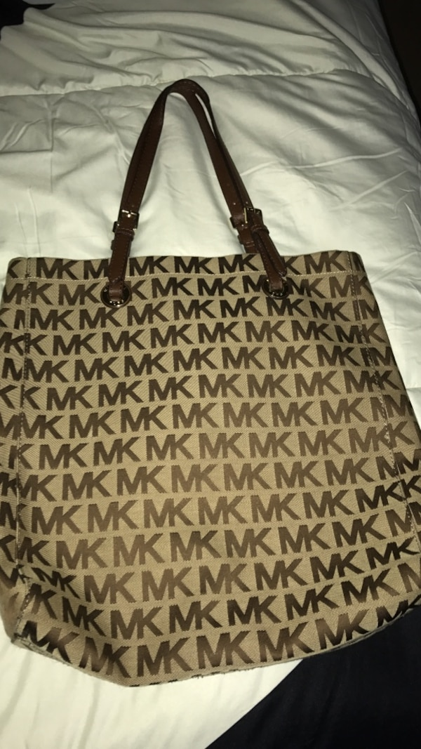 20215c63dc5f Used Beige and brown monogrammed Michael Kors tote bag for sale in New York
