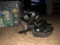 pair of black leather open-toe heeled sandals Port Richey, 34668