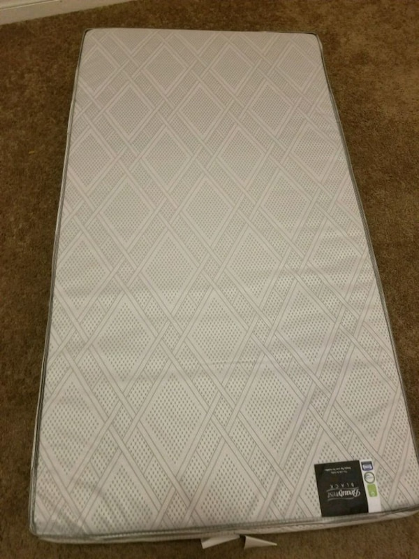 Dual sided infant/toddler mattress