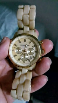 round gold-colored chronograph watch with link bra 40 km