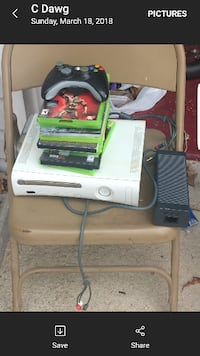 white Xbox 360 console with cases screenshot McDonough
