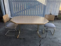 Brown wooden table with two chairs.. donations for grieving parents society Edmonton, T5L 3N9