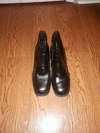 pair of black leather boots 542 km