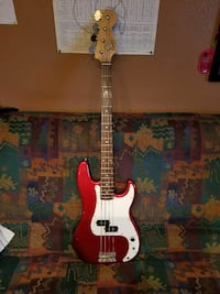 red and white bass guitar