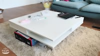 white wooden 2-drawer coffee table