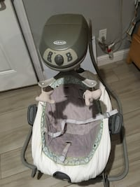 baby's gray and white cradle n swing
