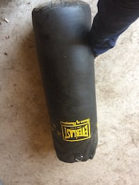 black and yellow Everlast heavy bag