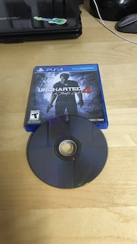 Sony PS4 Uncharted 4 game disc with case