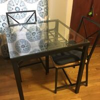 Metal frame glass top dining table