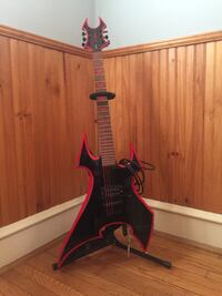 Black and red warlock guitar