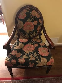 Brown wooden frame floral padded chair
