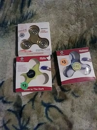 three assorted-color fidget spinner boxes 286 mi