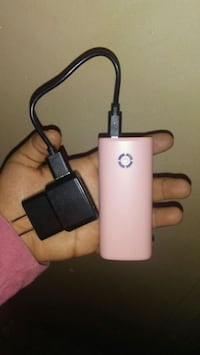 pink power bank and black travel charger