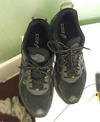pair of black Asics sneakers