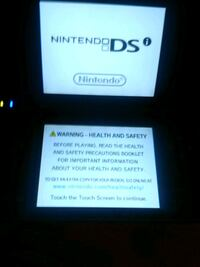 Nintendo dsi xl with 14 in 1 charger and pokemon Frederick, 21701