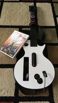 white electric guitar game controller