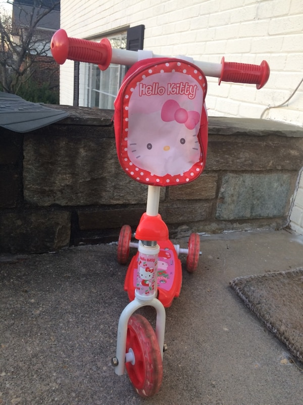 white and red hello kitty plastic trike 0