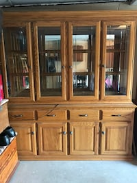 brown wooden TV hutch with cabinet