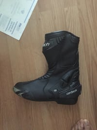 Black cortech motorcycle boot 2279 mi