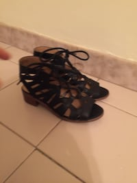 pair of black leather open-toe heeled sandals 550 km