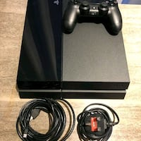 black Sony PS4 console with controller Michigan
