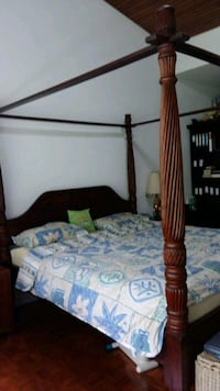 brown wooden bed frame with white and blue floral bedspread Singapore, 510451