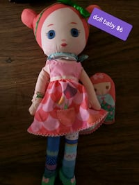 pink and white dressed doll