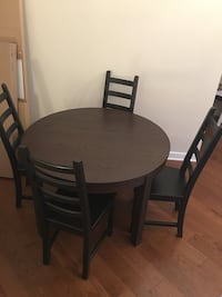 round brown wooden table with four chairs dining set Washington, 20037