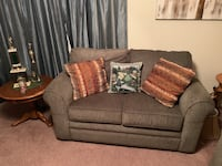 gray fabric 2-seat sofa with throw pillows Pearland, 77584