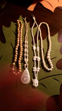 4 ivory and bone beads 776 km