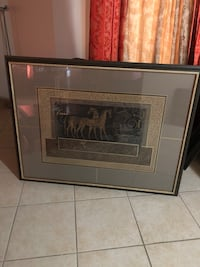 two brown horses painting with black frame