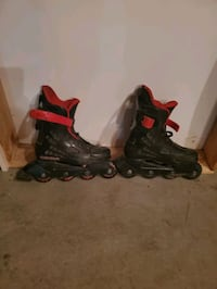Red and black roller blades. Size 8 Edmonton, T6T 0N7