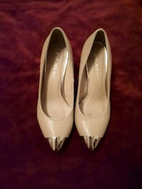 pair of beige leather flats Brossard