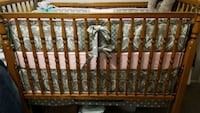 brown wooden crib with crib mobile Ashburn