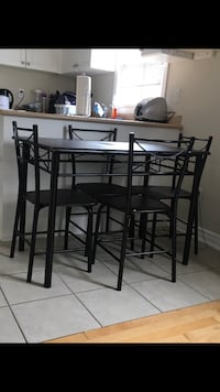 black steel framed glass top table with chairs Toronto, M6N 4C1