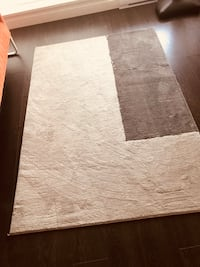 Grey and black carpet ikea . Excellent condition. Brand new .