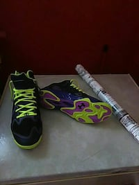 pair of purple-and-green Under Armour cleats Hattiesburg, 39401