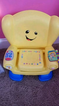 baby's yellow and blue plastic chair Owings Mills, 21117