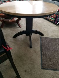 round brown wooden pedestal table Tucson, 85746