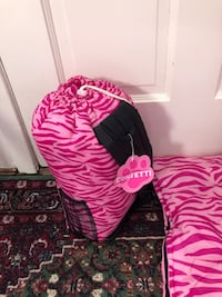 2 pink sleeping bags with cinch storage bags