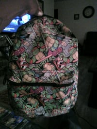 green, pink, and white floral backpack Tulsa, 74128