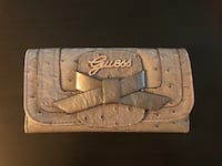 Gently used guess wallet  Calgary, T1Y